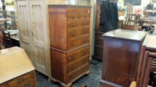 A late 20th century impressive inlaid Walnut chest on chest, eight drawers with brush sides,