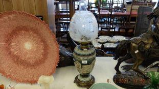 A Royal Doulton oil lamp,