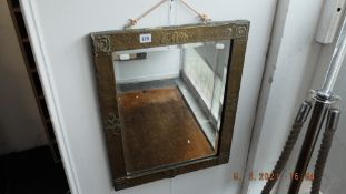 An early 20th century copper mirror