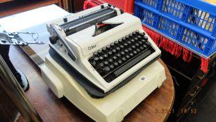 An electric typewriter and a portable typewriter