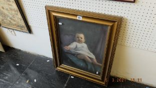 A portrait of a child framed