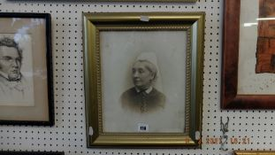 A framed portrait on glass, signed by Friese Greens and Simpson,