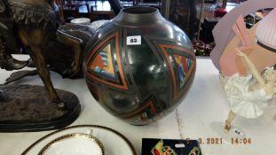 A brown art glass vase