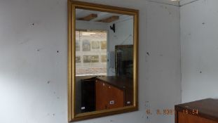 A gilt framed mirror