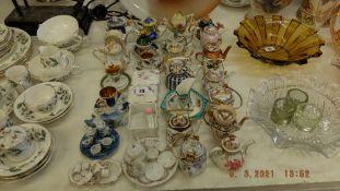 A qty of miniature teapots etc.