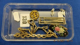 Six assorted white metal items inc. necklace, brooches etc.