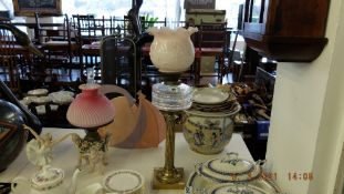 A brass Corinthian column oil lamp with cut glass font and Tulip shade and chimney