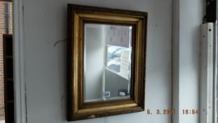 A gilt framed bevelled mirror, 46 x 36cm,