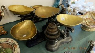Four sets of brass and metal scales weights
