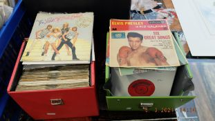 Two boxes of 1950's and 1960's 45's, records inc. Elvis etc.