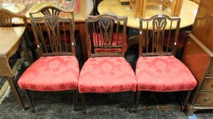 A set of four mahogany dining chairs