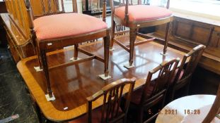 A Regency style table (with two leaves) and eight chairs