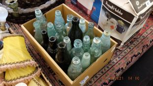 A box of assorted bottles