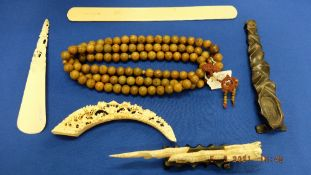 A collection of bone items, beads etc.