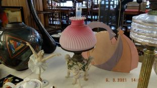A Victorian Sitledourf cherub oil lamp with matching satin shade and chimney