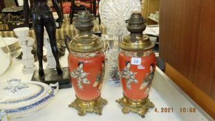 A pair of continental oil lamps