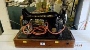 A Singer sewing machine with carry case