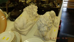 A pair of marbled laying Lions