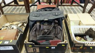 A leather briefcase and bags etc.