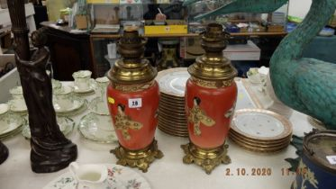A pair of oil lamps with oriental design to base including shades
