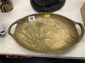 An Art nouveau brass two handled dish