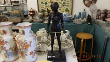 A bronze lady with cane