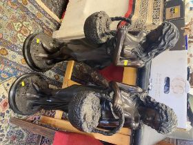 A pair of Bronze ladies with baskets