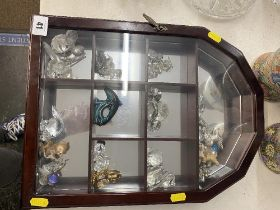 A small cabinet of crystal figures