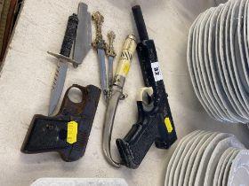 An air pistol, a starter pistol, knives etc,