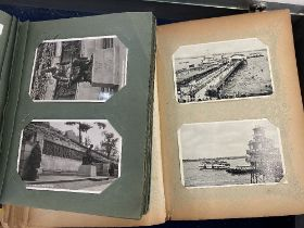 Two albums of postcards,