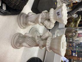 A pair of marble Cherub candlesticks