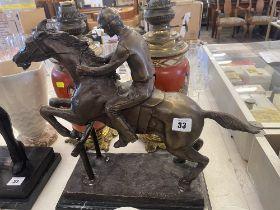 A bronze Racehorse/ Jockey statue,