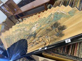 A Chinese decorative fan