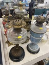 Five assorted oil lamps,