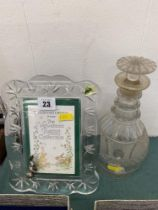 An antique Waterford decanter and a modern frame