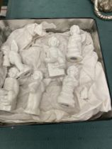 A collection of china cherubs