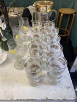 A decorative glass water jug, three commemorative large wine glass 'Diana,
