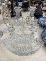 A qty of decanters, cut glass bowl etc.