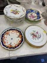 A large selection of assorted porcelain plates,