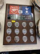 An Arsenal and Spurs Golf trophy,