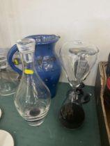 A hour glass, blue jug, black vase etc.