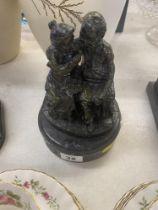 A bronze couple on base