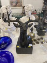 A Bronze Stag's head on a marble plinth,