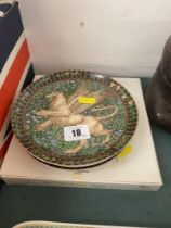 A set of four German decorative wall plates