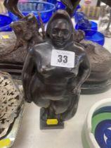 A bronze Botero style lady