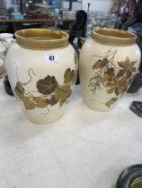 A pair of cream decorative Wedgewood vases,