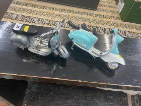 A model of a Vespa and Lambretta motor cars