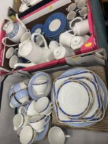 Two boxes of assorted china, tea sets etc.