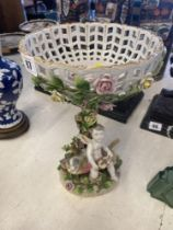 A Meissen centre piece, floral and Putties, a.