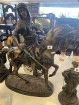 A bronze middle eastern man on horseback